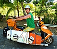 Surfboard transport with Scooter in Tobago